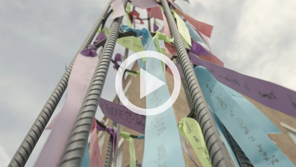 ribbons tied to a structure as part of the collaborative artistic response project
