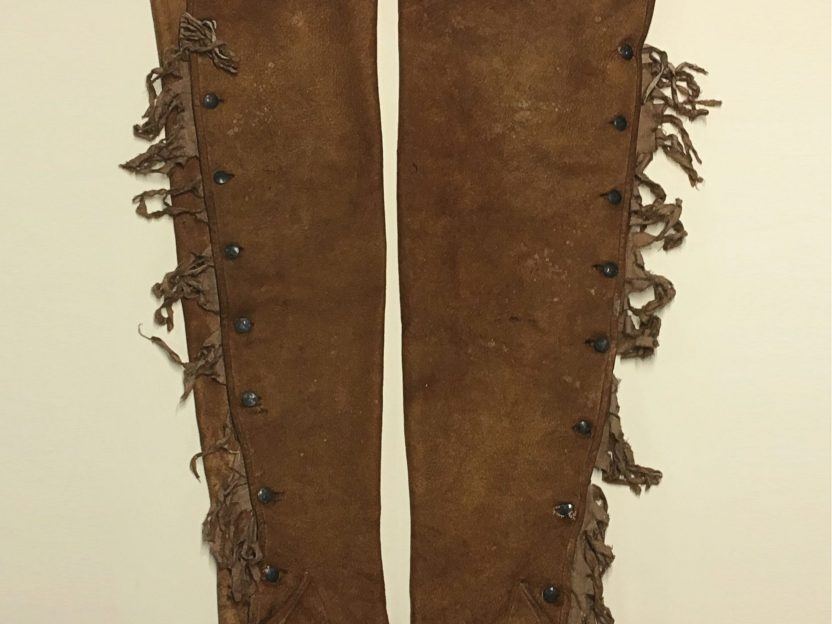 Photo of brown leather fringed leg stockings