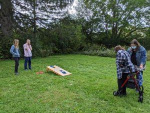 people playing corn hole