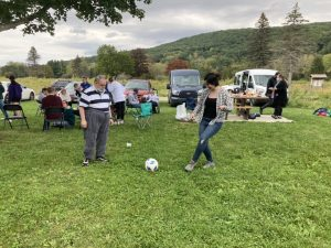 people playing soccer outdoors