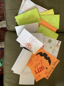 a stack of handmade cards