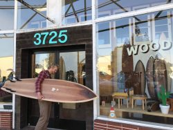 wooden surfboard shaper Chase Davenport, Williams Class of 2012, outside his office at the Wood Shop in San Francisco